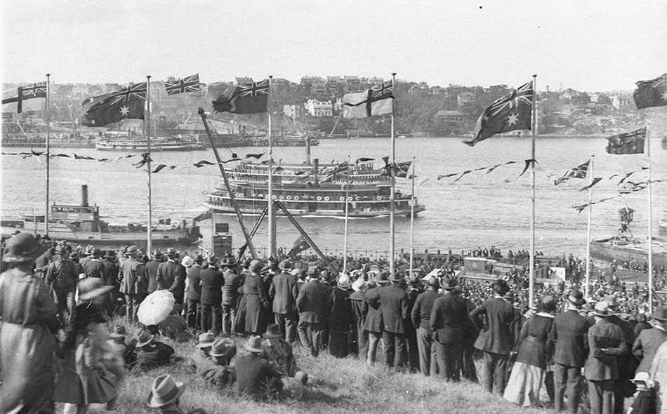 Crowds cheer from flag bedecked Dawes Point. Two ferries and a North Sydney vehicular ferry pass by, photographs by Sam Hood, 1925, Home and Away - 2157